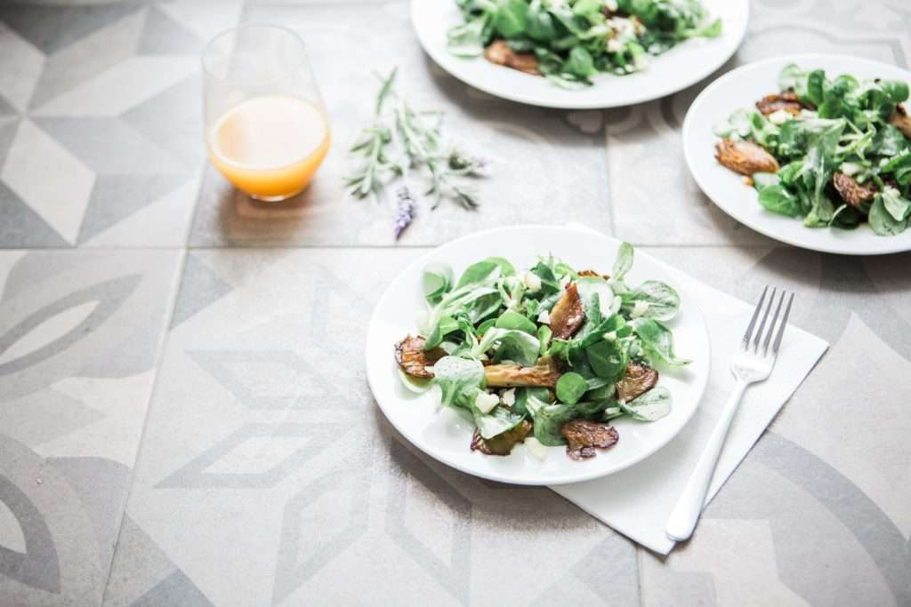 Plates of Lamb's Lettuce Salad with Mushrooms