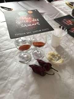 Samples of Piment d'Espelette chili powder in glasses