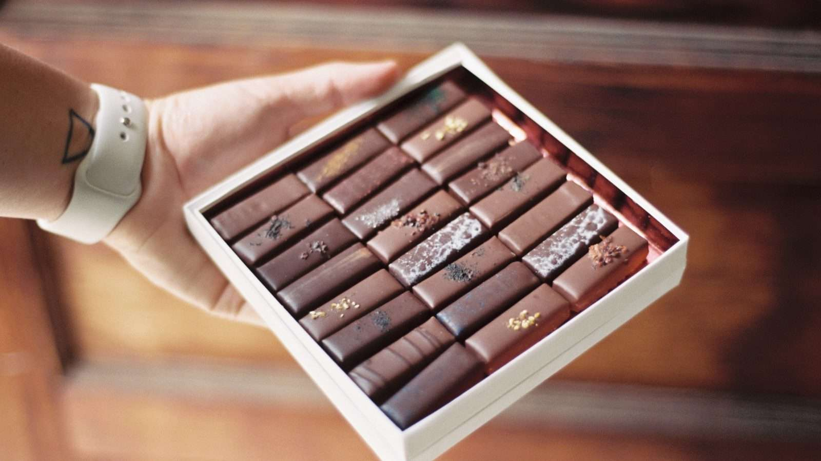 Man holding a box of chocolates
