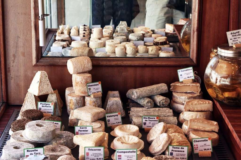 A selection of French cheeses in a shop.